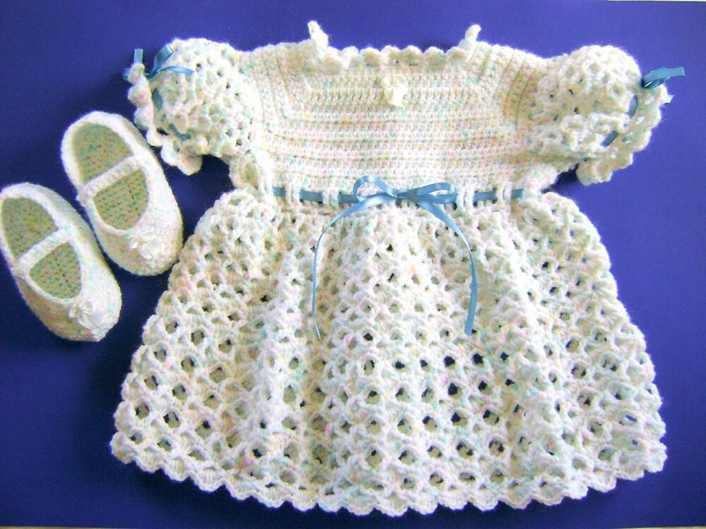 crocheted baby dress and booties