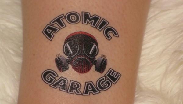 atomic tattoos girl gloss. Black Bedroom Furniture Sets. Home Design Ideas